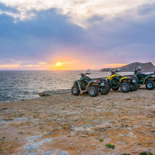 Quad Bikes On A Hill With A Nice Sunset