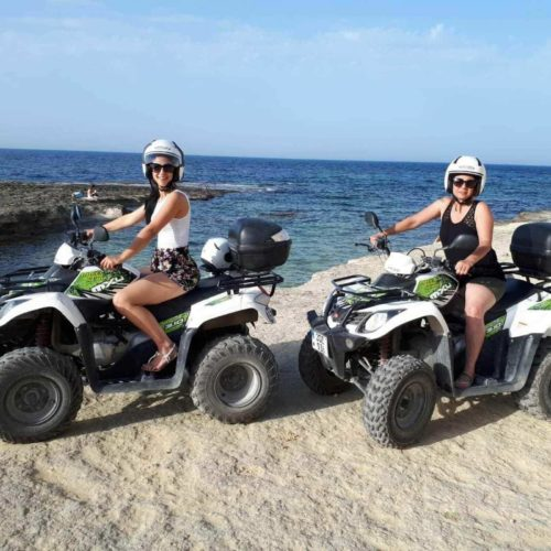 Two Females On Their Quad Bike Rental.